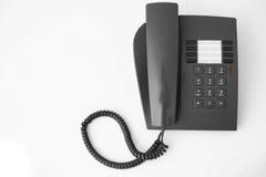 Telephone. Ordinary office black telephone isolated Stock Photo