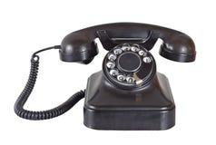 Telephone. Old vintage telephone on white stock image