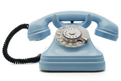 Telephone. A light blue telephone on white - with clipping path both for telephone and the dial Stock Photo
