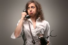 Telephone 485. A woman with cryng expression talking on the telephone Stock Photos