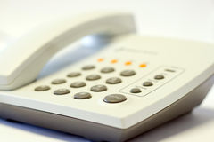 Telephone. A white modern telephone isolated in white background Royalty Free Stock Photo