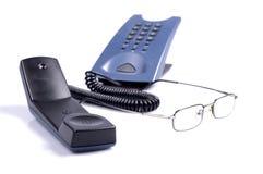Telephone. And eyeglasses isolated on white Stock Photo