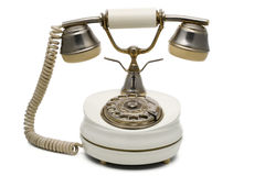 Telephone. A vintage white telephone on white with clipping path Stock Image