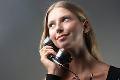 Telephone. A young woman at telephone Stock Photos