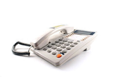 Telephone. White telephone with an earpiece on Stock Photos