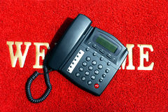 Telephone. On the red carpet with words Royalty Free Stock Photos