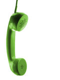 Telephone. Green retro telephone tube isolated on green