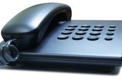 Telephone. Black telephone on a white background Royalty Free Stock Photo