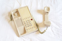 Telephone on bed sheet Stock Photography