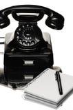 Telephone. Black bakelite telephone and note pad royalty free stock photos