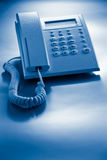 Telephone blue toned Stock Images