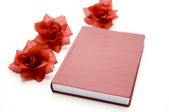 Telephone book with rose blossoms Stock Images