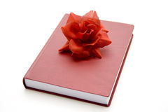 Telephone book with rose blossoms Royalty Free Stock Images