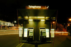 Telephone booth. Night scene, telephone booth, lights from moving cars Royalty Free Stock Photos