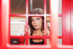 At the telephone booth. Stock Image