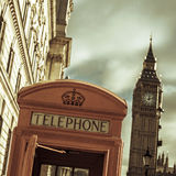 Telephone booth and the Big Ben in London, United Kingdom, with. A view of a classic red telephone booth and the Big Ben in the background, in London, United Stock Photography