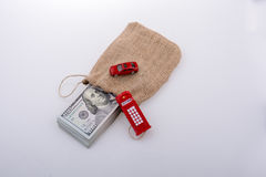Telephone booth, car  and bundle of dollar Royalty Free Stock Photos