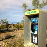 Telephone booth in Death Valley. USA. Spring desert. royalty free stock photography