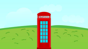 Telephone booth in the field Stock Image