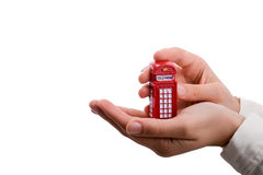 Telephone booth in hand. On a white background Royalty Free Stock Image