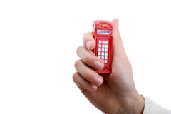 Telephone booth in hand. On a white background Royalty Free Stock Photos
