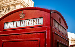 Telephone booth, London. The upper part of the telephone booth in London with the sign Royalty Free Stock Photo