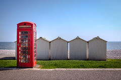Telephone booth on the seafront Stock Images