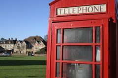 Telephone booth on village green Royalty Free Stock Photos