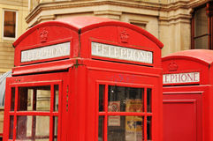 Telephone booths. Retro style British red telephone booths Royalty Free Stock Photo
