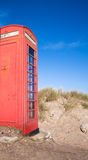 Telephone Box on a Beach Stock Image