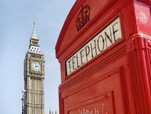 Telephone box with Big Ben in background. Royalty Free Stock Photos