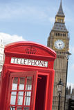 Telephone box with Big Ben clock tower, London, UK, vertical Royalty Free Stock Photography