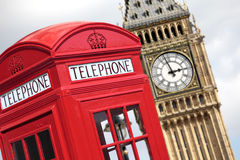 London British UK red telephone box Big Ben. Traditional red telephone box with Big Ben out of focus in the background Stock Images