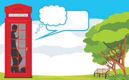 Telephone box on the landscape background Stock Photography