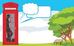 Telephone box on the landscape background stock photography