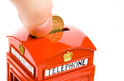 Telephone box money bank Stock Photo