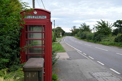 Old Fashioned Red Telephone Box, England, UK. An old red telephone box in an English village britain british call calling communicate dial emergency england stock photos