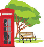 Telephone box in the park stock photos