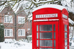 Telephone box with snow. Old English red phone box in winter scene Stock Photo