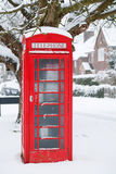 Telephone box in UK. Traditional English phone box in an English village Royalty Free Stock Photo