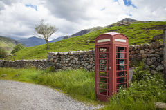 Telephone boxe in red. A typical English red telephone box Royalty Free Stock Photo