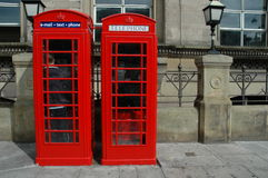 Telephone boxes. Two British telephone boxes outside a historical building in London, England Royalty Free Stock Image