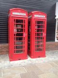 Telephone boxes outside. Stock Images