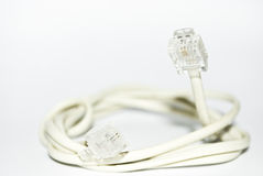 Telephone cable. Closeup of white telephone cable against white background stock photo