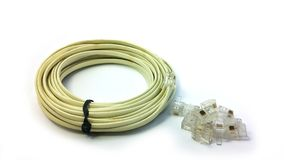 Telephone cable and pile of RJ11 isolated on white paper. RJ11 for telephone connecter Stock Images