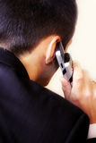 Telephone call. A young business man is calling Stock Photo