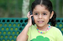 Telephone call. A little girl talking by cellphone Stock Photo