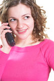 Telephone call. Young woman is making phone call. Isolated stock image