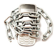 Telephone in a chain on a white background Stock Photography
