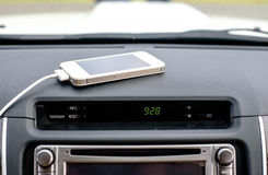 Telephone Charger in Car, focus charger line Stock Photo